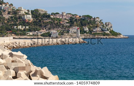 Concrete breakwater with lighthouse in French Riviera. Entrance to the Port of Nice, France #1405974809