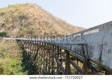 Concrete bridge across the deep gorge in the valley, Thailand #715720027