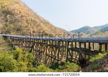 Concrete bridge across the deep gorge in the valley, Thailand #715720054