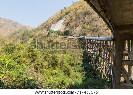 Concrete bridge across the deep gorge in the valley, Thailand #717437575