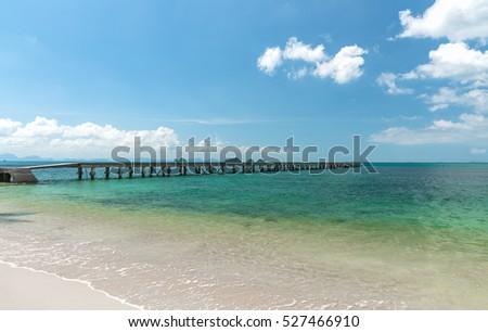 Concrete bridge on the beach to the sea. sunny day