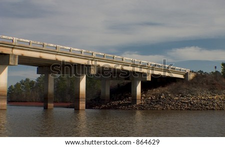 Concrete bridge spanning the lake