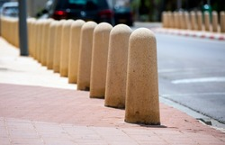 concrete column safety barrier on a city street