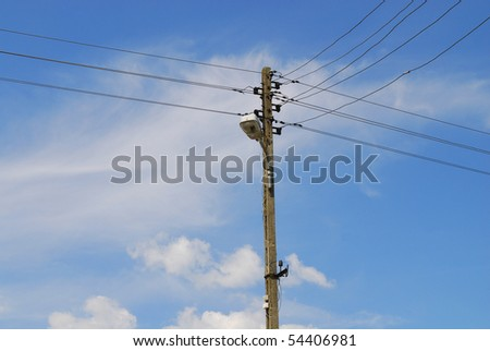 concrete column with the wires against the sky