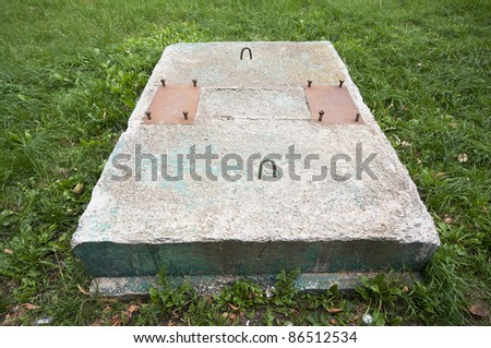 concrete  construction and grass - stock photo