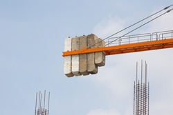 concrete counterweight of tower crane over site construction.