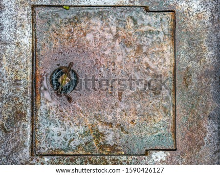 concrete cover to hole in sidewalk  Stock fotó ©