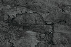 Concrete dark vintage tiling texture and background. Old cement dark grey scratched  wall with cracks. Graphic resource.