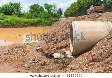 Concrete Drainage Pipe on a construction Site .Concrete pipe sewage water system aligned on site in Thailand. #469517372