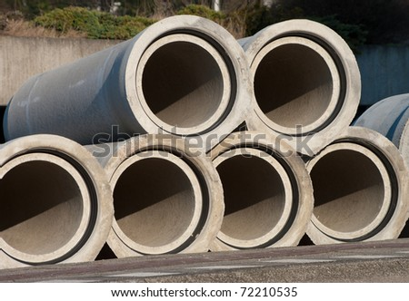 concrete drainage pipes in the street