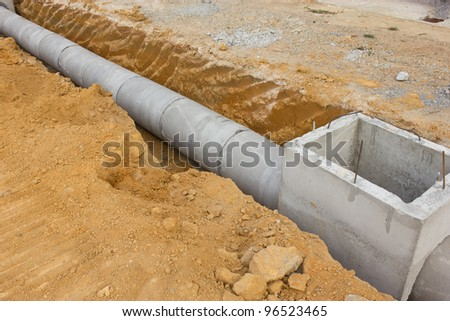 Concrete drainage tank on construction site