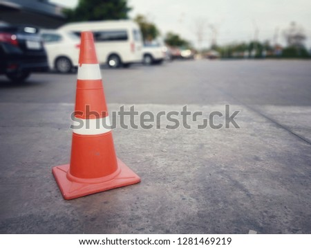 Concrete floor with red cone #1281469219