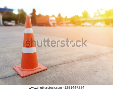Concrete floor with red cone #1281469234