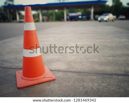 Concrete floor with red cone #1281469342