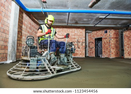 Concrete flooring. using ride-on power trowelling machine for surface floating