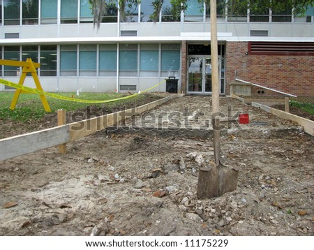 concrete form built in preparation to pour a new sidewalk - stock photo