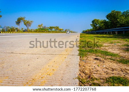 Concrete highway road of Yamuna expressway from Delhi to Agra. Agra Yamuna expressway starts from Delhi connects Mathura and Vrindavan then leads straight to Agra city located in Uttar Pradesh, India.