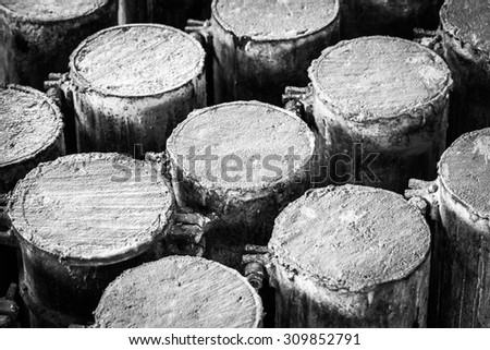 Concrete in steel cylinder formwork for testing of strength compaction in black and white