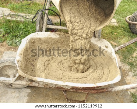 Concrete mixer detail. Making concrete in the mixer at the construction site