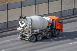 Concrete mixer truck rides on city highway