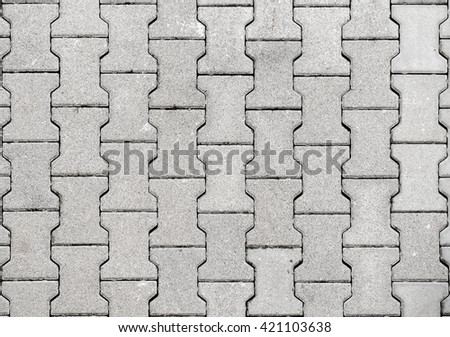 Concrete or cobble gray H Shaped pavement slabs or stones  for floor, wall or path. Traditional fence, court, backyard or road paving.