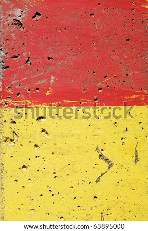 Concrete painted with red and yellow, suitable for background texture.