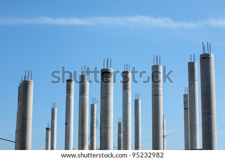 concrete pillar against blue sky - stock photo