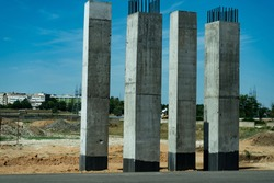 Concrete pillars for an aero duct at the roadside.