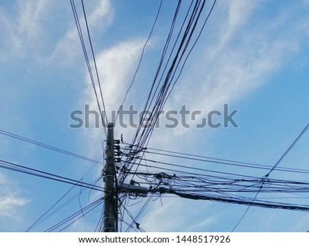 Concrete pole with electrical wires and communication wires.  #1448517926
