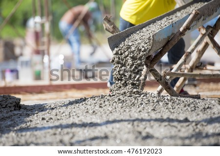 Concrete pouring during commercial concreting floors of building #476192023