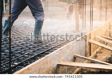 Concrete pouring during commercial concreting floors of buildings in construction - concrete slab #741611305
