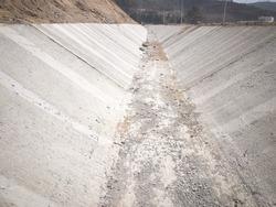 Concrete rain water drainage tray at construction site. Rain water drainage gutter. Concrete structure for rain water draining