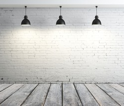 concrete room with three ceiling lamps