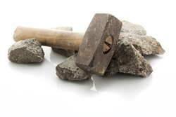 Concrete rubble debris with hammer isolated on white