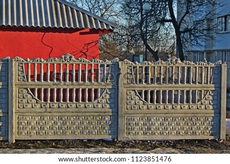 Concrete sectional fence at the house, two sections #1123851476