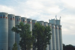Concrete silos for storage of cereals and their products.  Flour mill and warehouse.  Silo near the railway.  Concrete towers and socialism with its architecture.