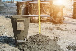 Concrete Slump Testing of mixing concrete checking workability in field construction site
