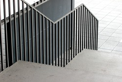 Concrete stair with a metal fence