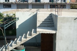 Concrete staircase leading to the roof of a one-story building