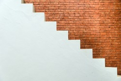 Concrete Staircase with brick wall in residential house building of construction industry - side view