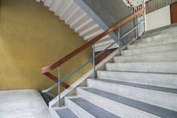 Concrete stairs are wooden handrails