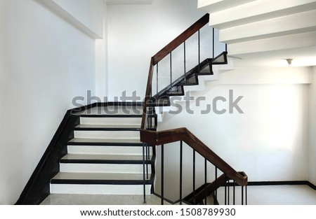 concrete stairs are wooden handrails. ladder in the building. Empty modern building stairway Stock photo ©