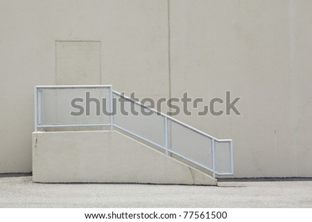 concrete stairs on back of warehouse