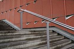 Concrete stairs step with metal handle rail bar outdoor