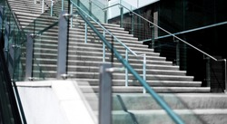 Concrete stairs with glass side rails outside