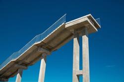 Concrete stairway to heaven. Metal railing.