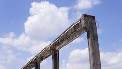 Concrete structure of railings against blue cloudy sky