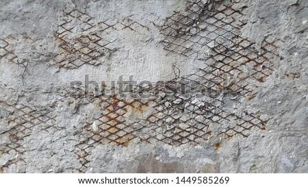 Concrete surface. Concrete. Destroyed concrete surface reinforced mesh. Vintage abstract background. Old destroyed concrete surface #1449585269
