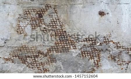 Concrete surface. Concrete. Destroyed concrete surface reinforced mesh. Vintage abstract background. Old destroyed concrete surface #1457152604