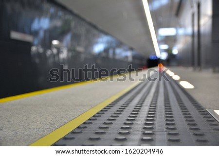 Concrete tactile strips with an yellow line - for visually impaired (handicapped) and people with blindness - on an underground station Zdjęcia stock ©